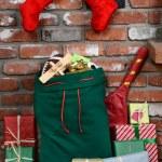 Santa Claus Bag on Hearth — Stock Photo #60135453