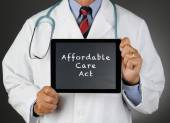 Doctor Tablet Computer Affordable Care Act — Stock Photo