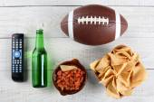 TV Remote, Salsa, Beer, Chips and Football — Stock Photo