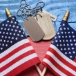 Dog Tags and Flags on Patriotic Table — Stock Photo #66774897