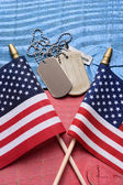 Dog Tags and Flags on Patriotic Table — Stock Photo