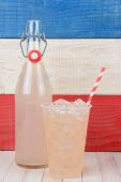 Lemonade Bottle and Glass — Stock Photo