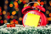 Alarm clock with christmas lights — Stock Photo