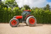 Man with tractor in a garden, blurred motion — Stock Photo