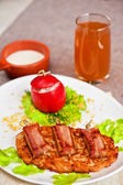 Veal meat with bacon — Stock Photo