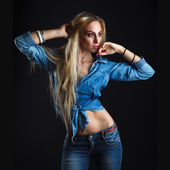 Beautiful woman body in jeans — Stock Photo