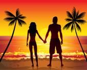 Couple  on beach at sunset — Stock Vector