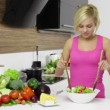 Woman mixing a salad — Stock Video #61855885