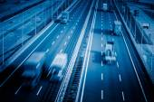 Motion trucks on the freeway — Stock Photo