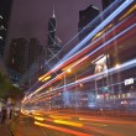 HONGKONG -SEPTEMBER 2 2013: Car light trails and urban landscape — Stock Photo #54258283