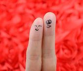 Happy couple with painted smiley — Zdjęcie stockowe
