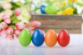 Decorated eggs and spring flowers — Stock Photo
