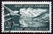 Postage stamp Yugoslavia 1951 Plane over Gulf of Kotor — Stock Photo