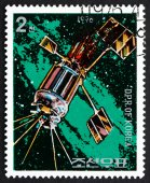 Postage stamp North Korea 1976 Satellite, Day of Space Flight — Stock Photo