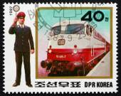 Postage stamp North Korea 1987 Expres Train and Ticket Inspector — Stock Photo