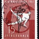 Postage stamp Yugoslavia 1957 Gymnastic Position, Pommel Horse — Stock Photo #53290611
