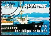 Postage stamp Guinea 1998 Bow of Greenpeace Ship — ストック写真