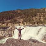 Happy man in Kootenai Falls — Stock Photo #74894143