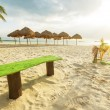 Tropical beach with parasols — Stock Photo #75426533