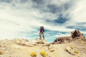 Hiking man in the mountains — Stock Photo