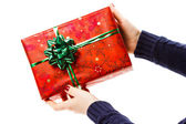 Hands with christmas gift — Stock Photo