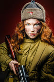 Historical reenactment of soviet union army by pretty girl with  — Stock Photo