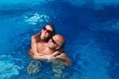 Happy couple in pool — Stock Photo