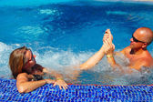 Foot massage in jacuzzi — Stock Photo