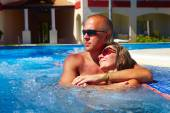 Loving couple in jacuzzi. — Stock Photo