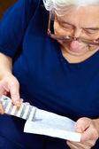 Senior female with pills — Stock Photo