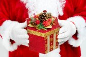 Hands of Santa Claus with gift — Stock Photo