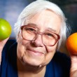 Senior woman with fruits — Stock Photo #59457091
