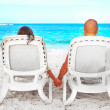 Couple relaxing on sunbed — Stock Photo #59533553