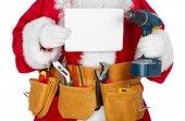 Santa Claus s pásem nástroj. — Stock fotografie