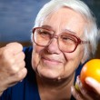 Senior woman with fruits — Stock Photo #59653535