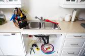 Plumbing tools on the kitchen. — Stock Photo