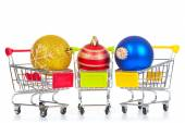 Christmas toys in shopping cart — Stock Photo