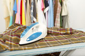 Electric iron and shirt — Stock Photo