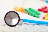Stethoscope on the keyboard — Stock Photo