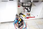Plumbing tools on the kitchen. — Stok fotoğraf