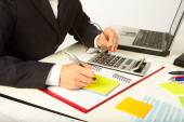 Businesswoman working with calculator — Stock Photo