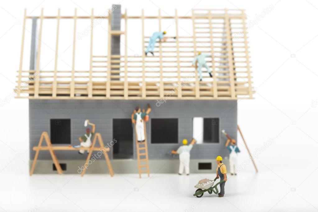 别墅房子的建设.在家里举行的建筑工地的工人— photo by petrkurgan