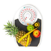 Scales and fruit — Stock Photo