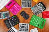 Calculators lying on the wooden flooring — Stockfoto