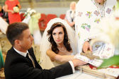 Bride and groom in the church — Stock Photo