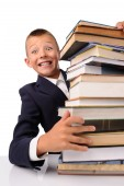 Surprised schoolboy with huge stack of books — Foto de Stock