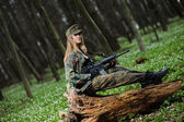 Beautiful army girl with gun — Stock Photo