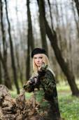 Beautiful army girl with gun — Stock Photo