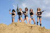 Beautiful army girls  with guns — Stock Photo