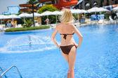 Sexy young woman near swimming pool — Stock Photo
